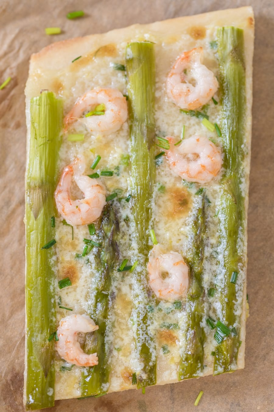 Slice of shrimp asparagus flatbread with zesty mascarpone sauce.