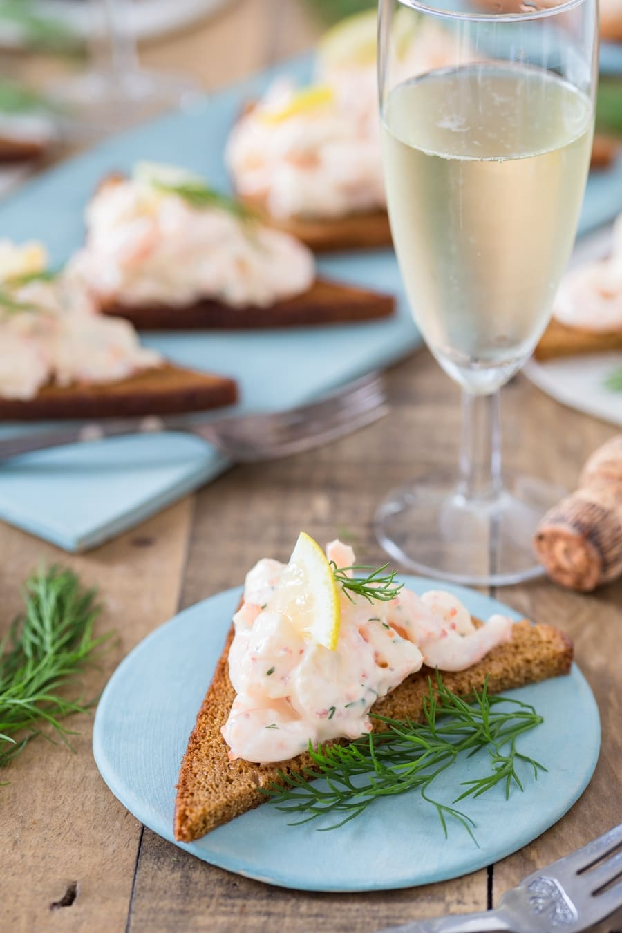 Single rye toast topped with skagenröra shrimp salad.