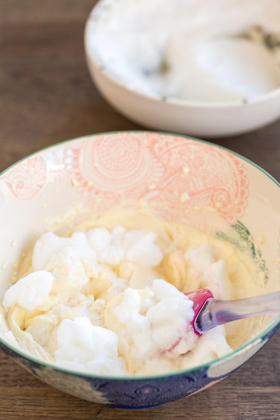 Folding egg whites into mascarpone cream.