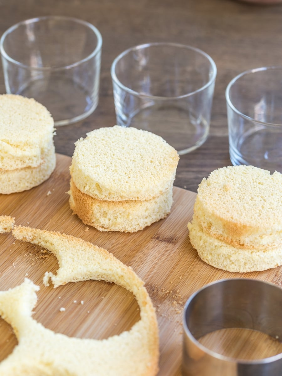 Sponge cake discs cut out from larger form to be used in smaller serving glasses.