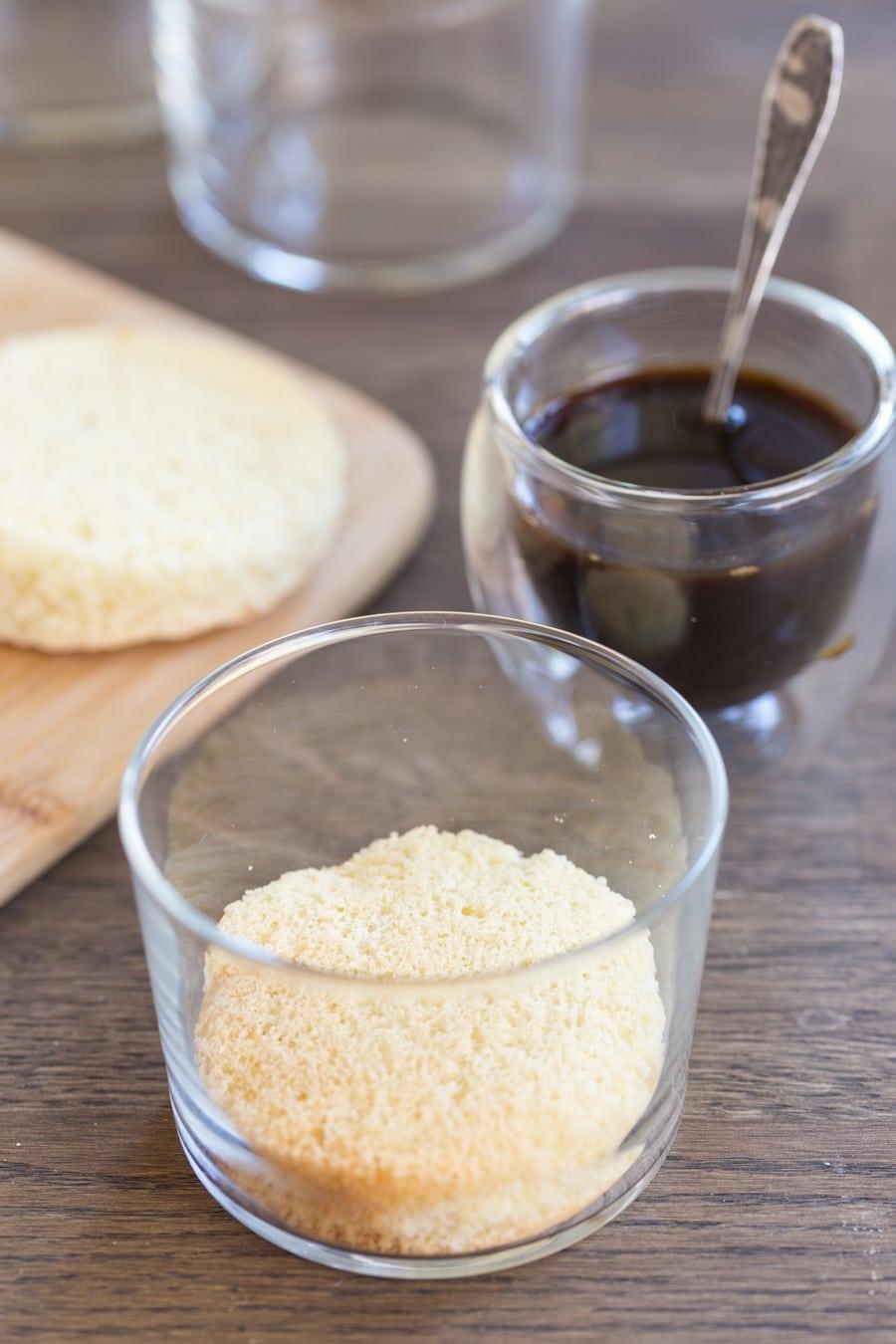 Tiramisu in a glass procedure: add the sponge cake to a glass.