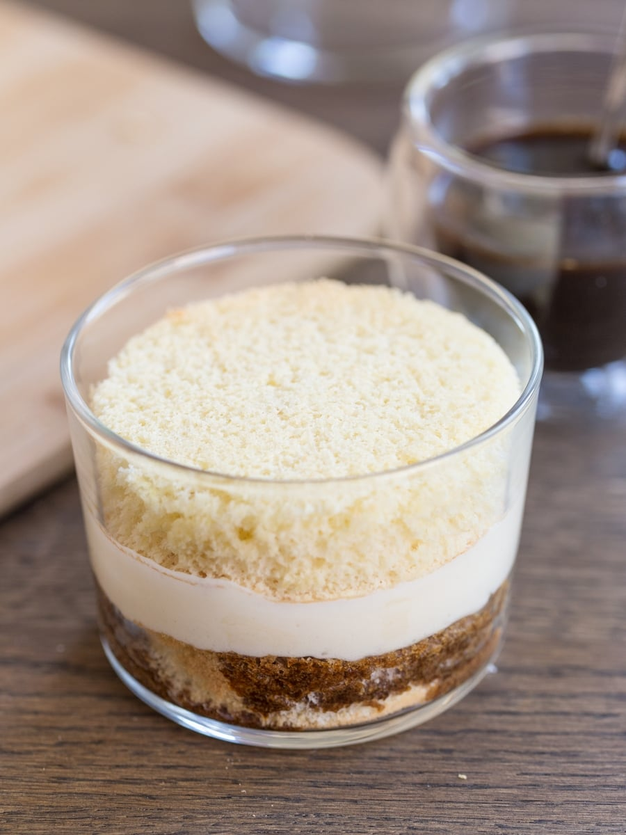 Tiramisu in a glass recipe: the next layer of sponge cake is added to the glass.