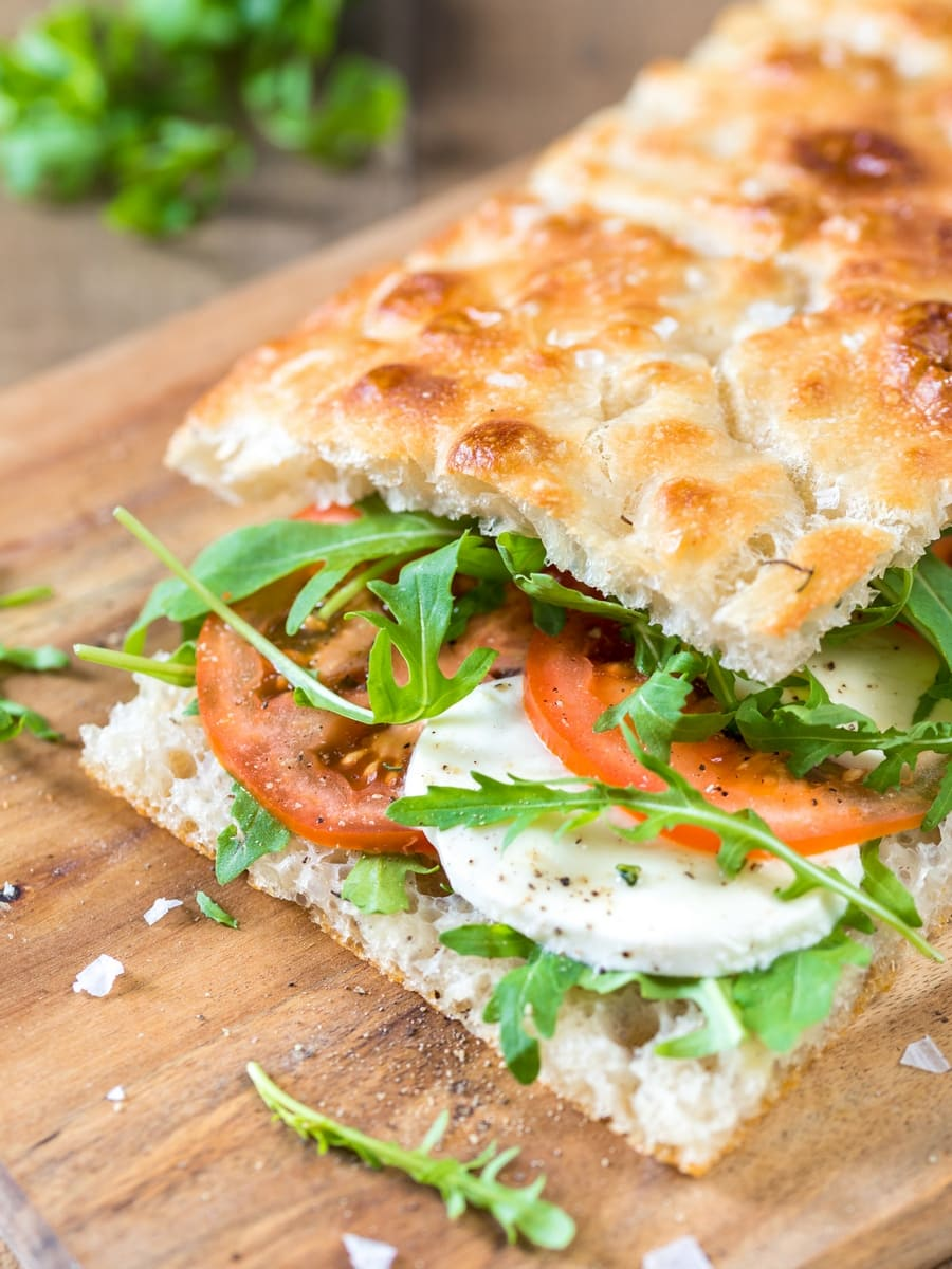 Focaccia filled with caprese salad: tomato and mozzarella on focaccia bread.