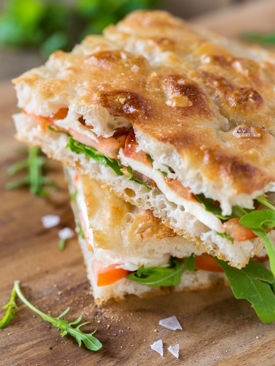 Caprese focaccia sandwich: focaccia bread filled with tomato mozzarella rocket.
