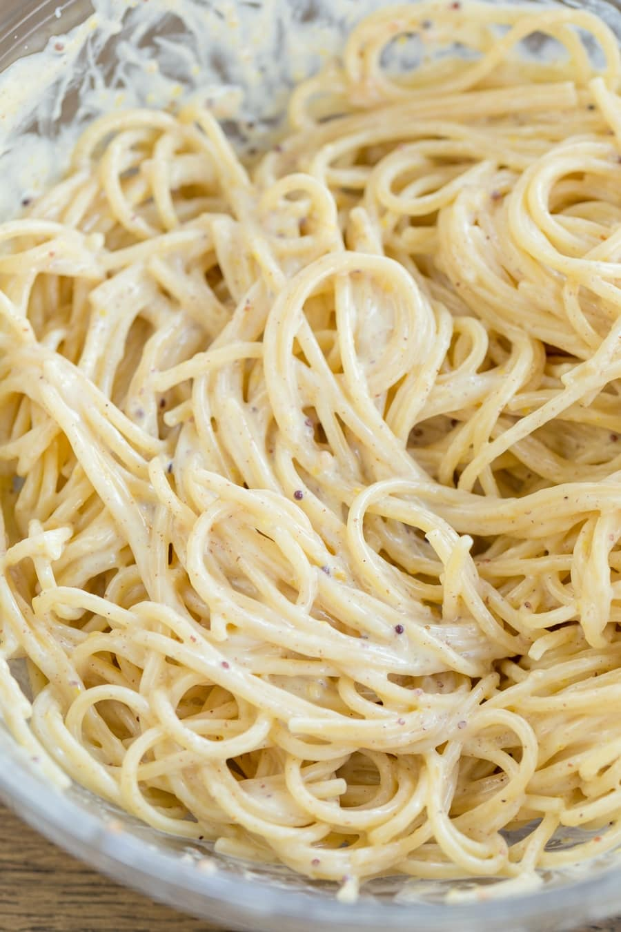 Spaghetti with creamy mustard sauce in a bowl.