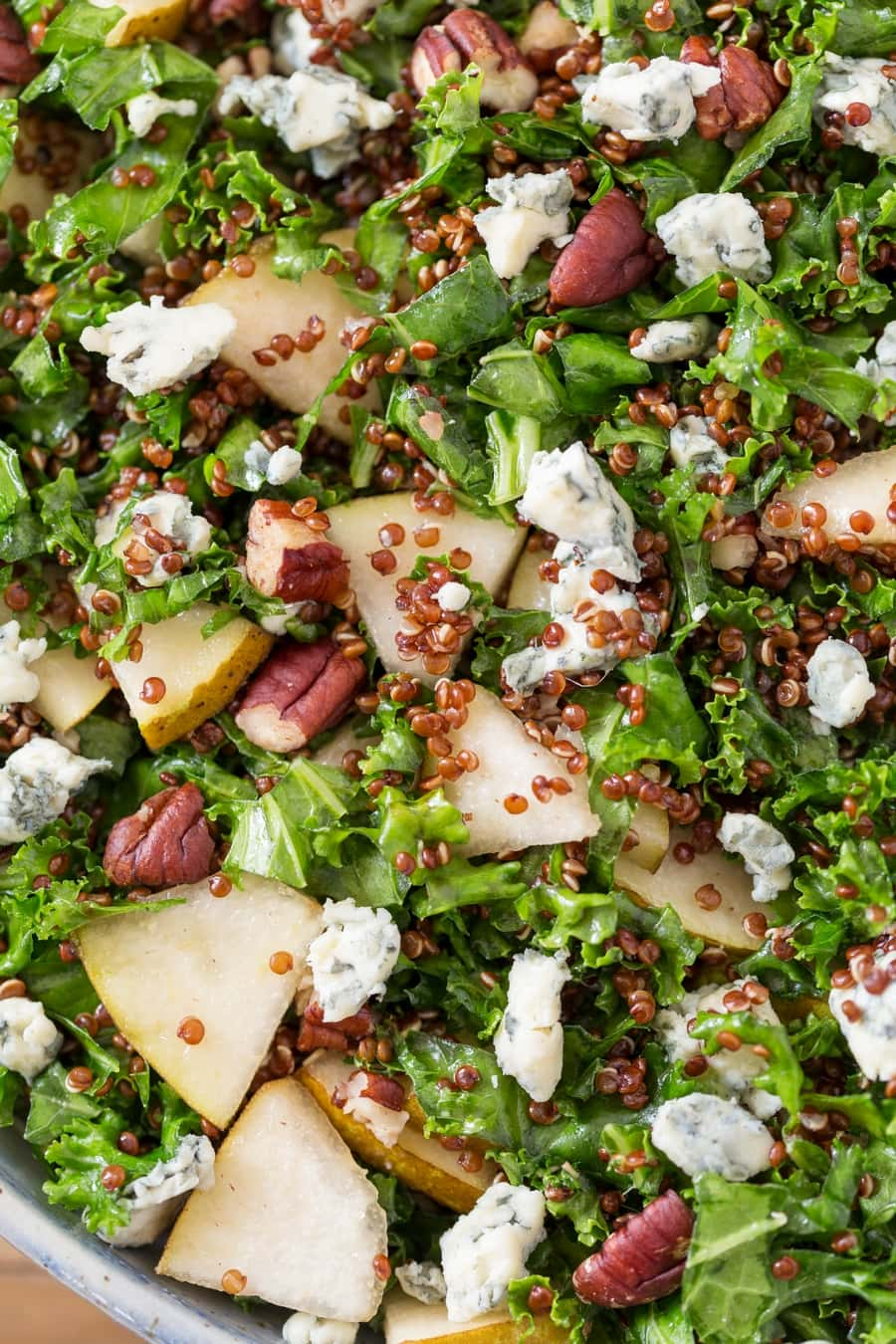 Closeup of pear blue cheese kale salad.