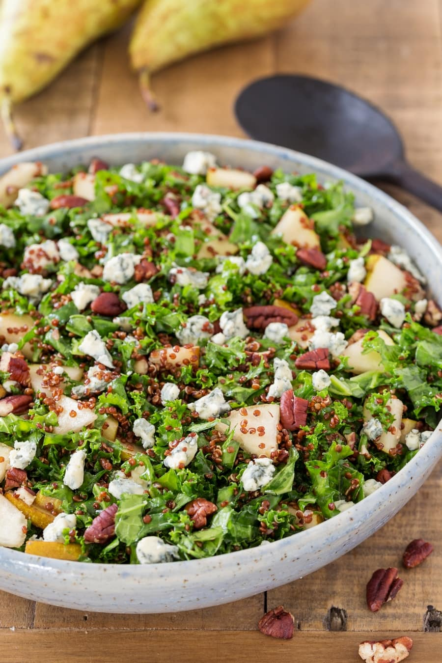 Pear and blue cheese kale and quinoa salad in a bowl.