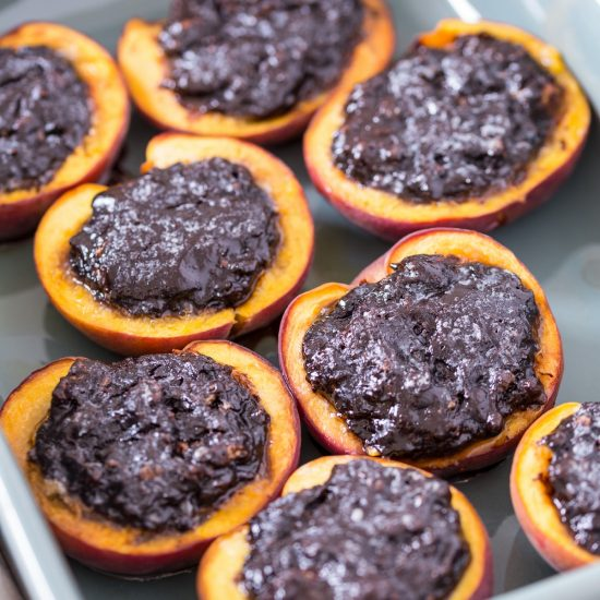 Amaretti stuffed peaches are a baked peach dessert from northern Italy. Perfect when peaches are in season, fresh peaches are halved, carved and stuffed with a cocoa and amaretti filling. Baked and served lightly warm they are a delicious way to use your fresh peaches in season.