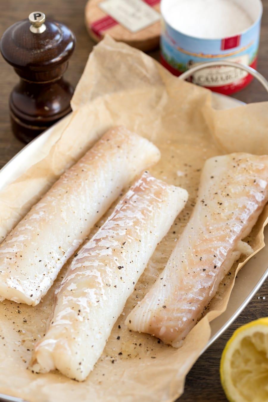 Cod fillets seasoned with back pepper and lemon juice.