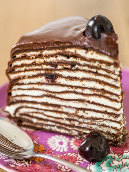 Slice of Black forest crepe cake.