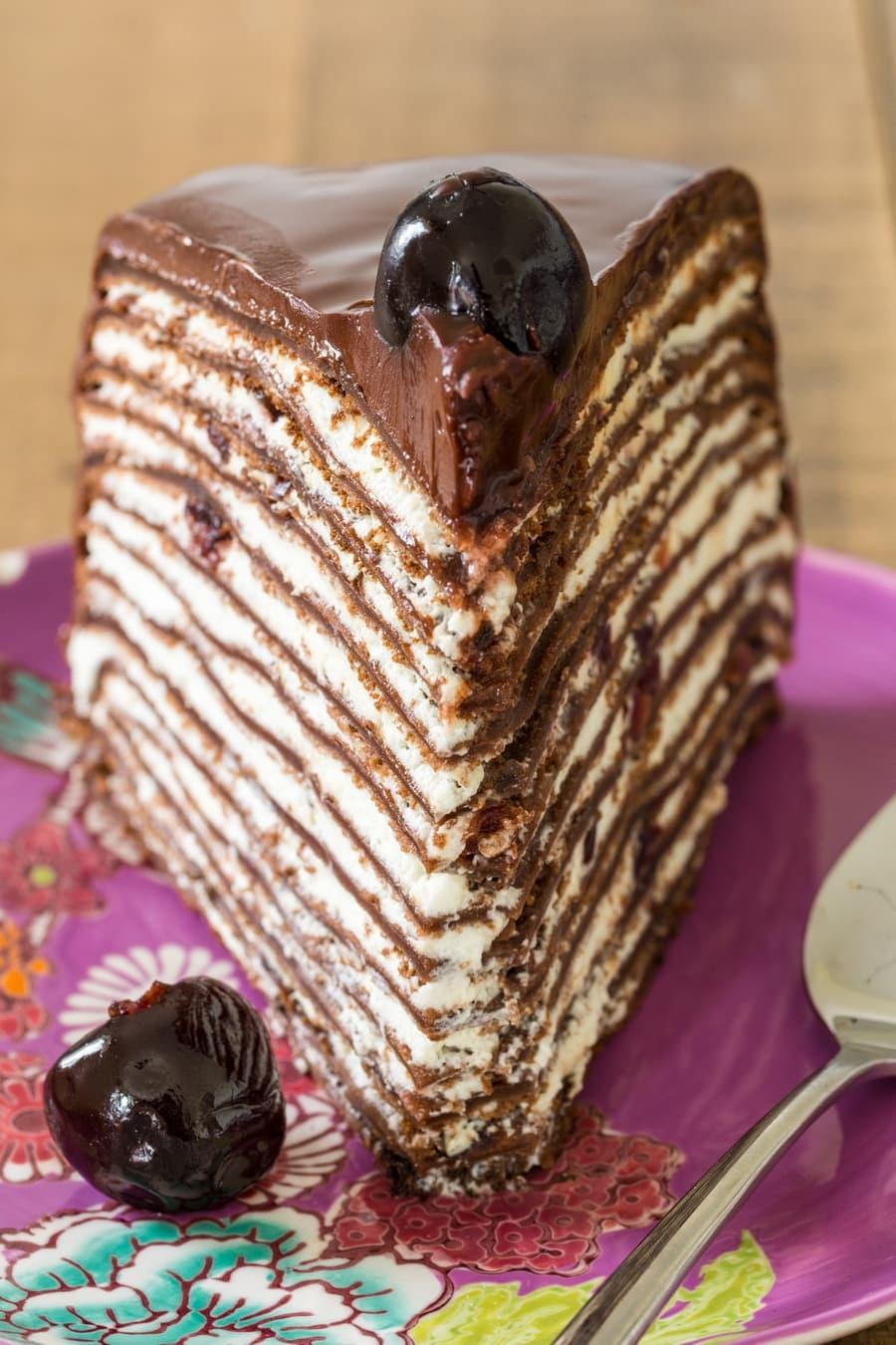 Slice of Black forest crepe cake.