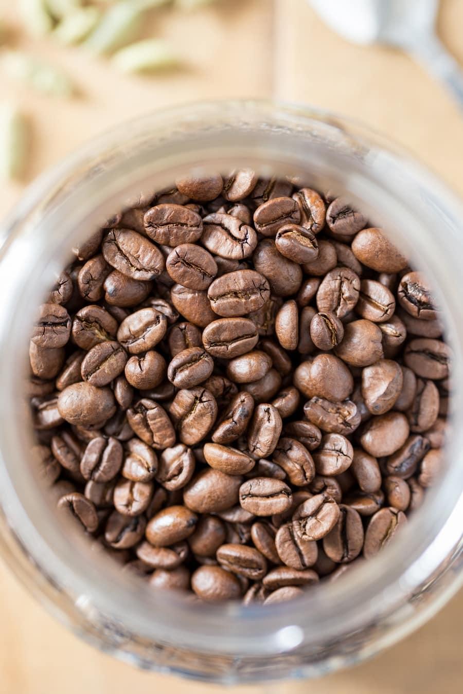 Coffee beans in a mason jar, overhead.