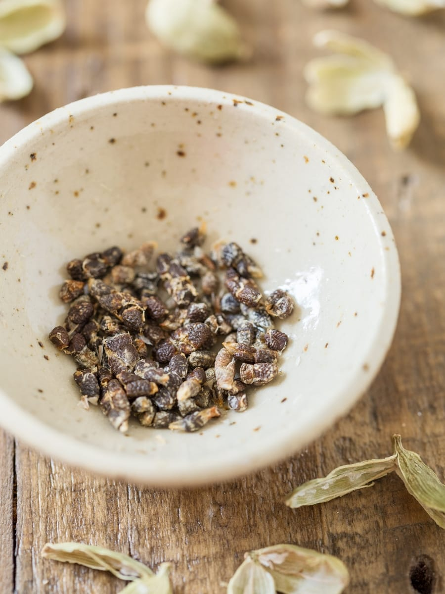 Cardamom seeds in a small bowl.