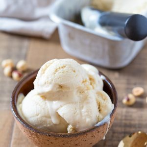 No-churn hazelnut ice cream served in a brown bowl.
