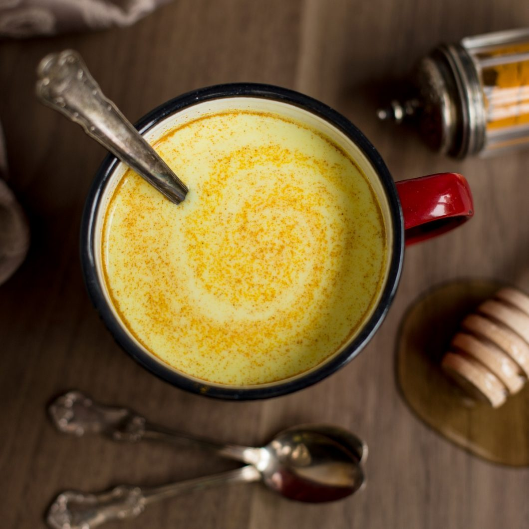Hot milk and rum with turmeric and honey: a cozy beverage for the fall. Not as spiced as your average turmeric latte, this golden milk recipe is instead spiked with a splash of rum. Make this hot milk and honey beverage to fend off a cold or just to enjoy a warm beverage on a cold day.