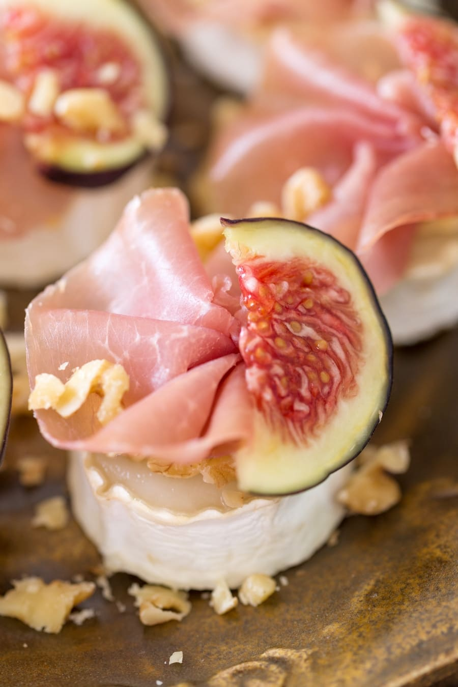 Baked chevre bits with figs and prosciutto.