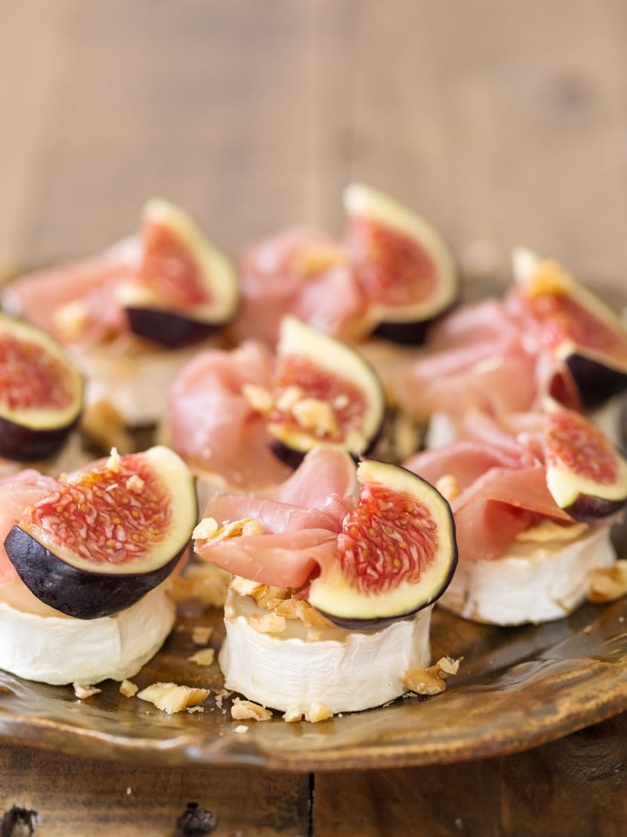 Baked goat cheese slices with walnuts, figs and prosciutto.