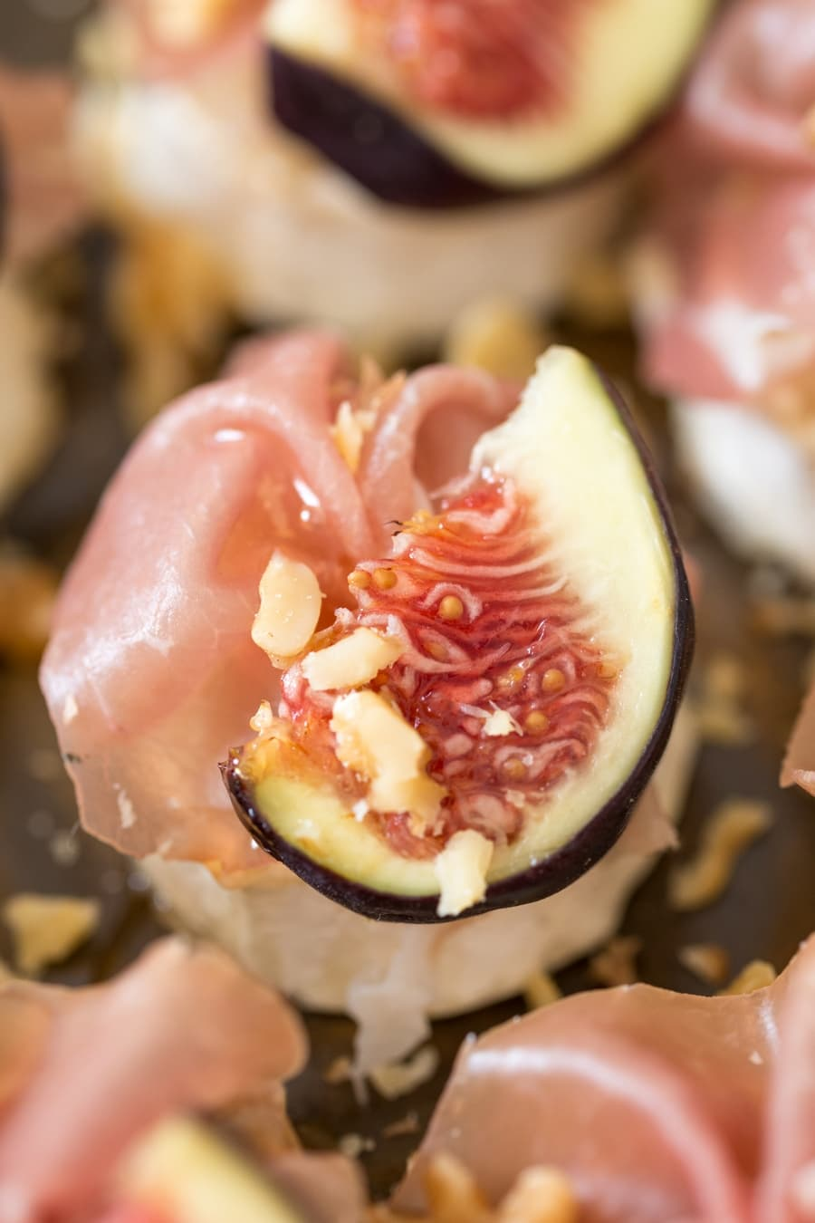 Baked goat cheese log with figs and prosciutto.