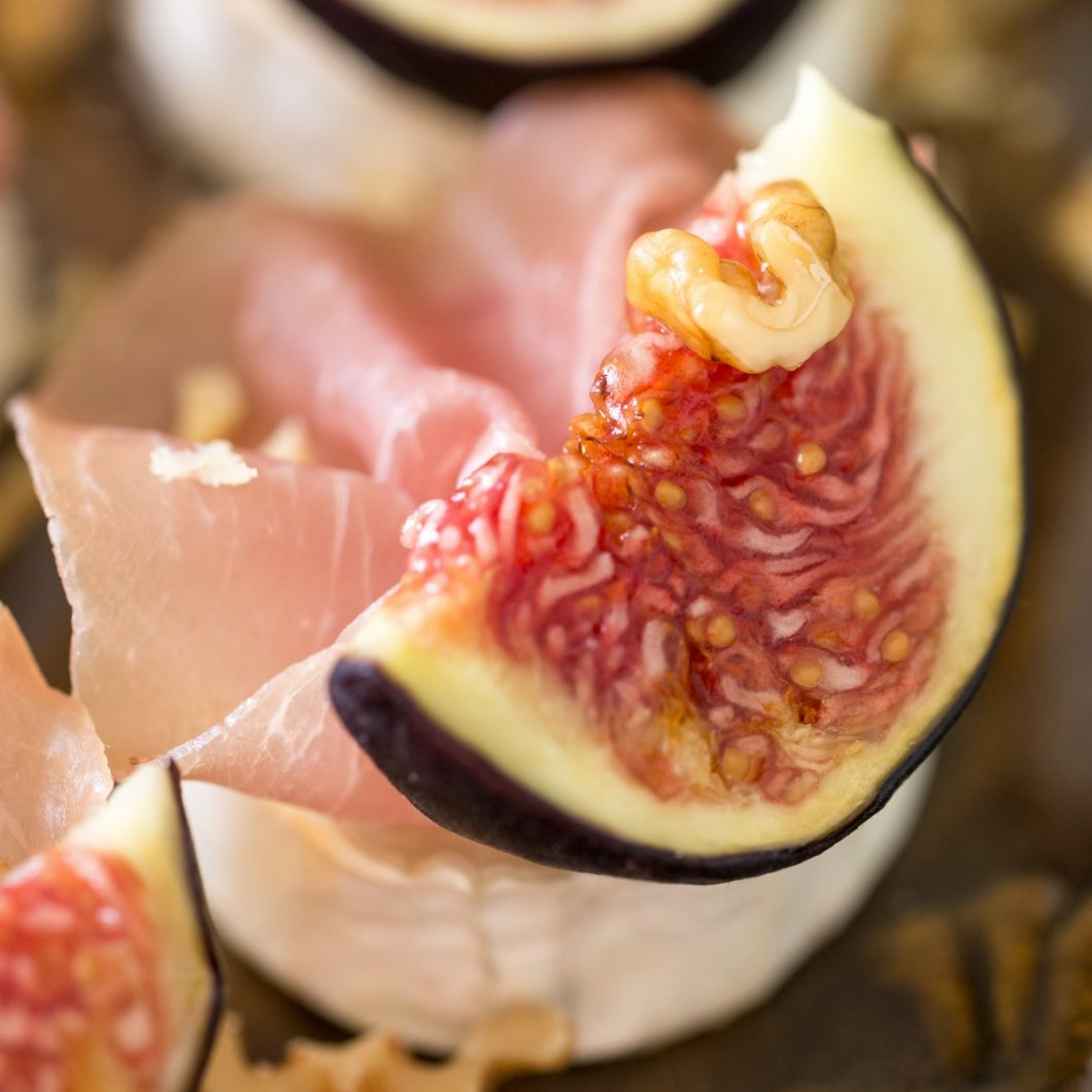 Baked chevre bits with fresh figs, walnuts and prosciutto.