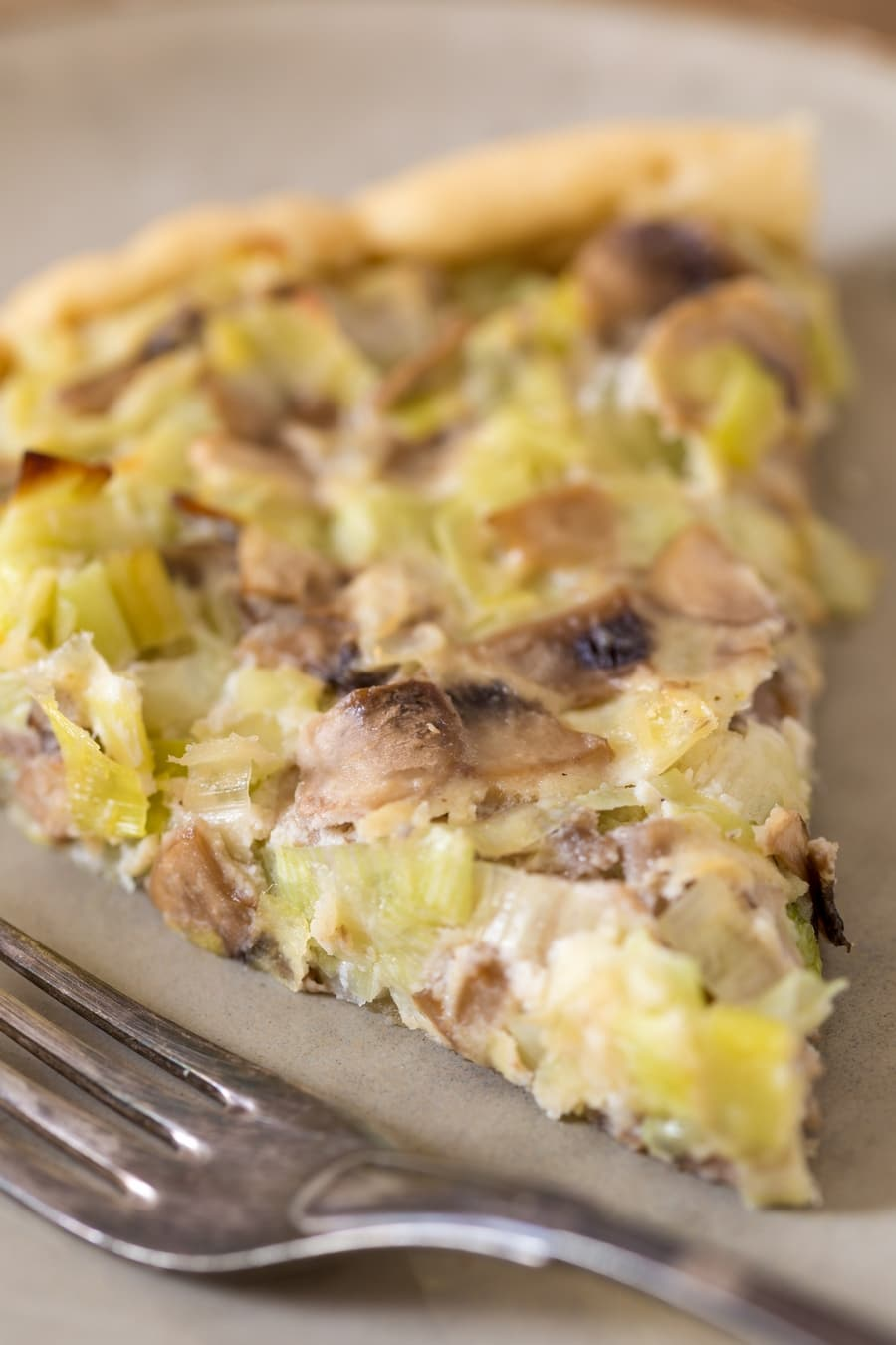 Closeup of mushroom ricotta pie with leeks.