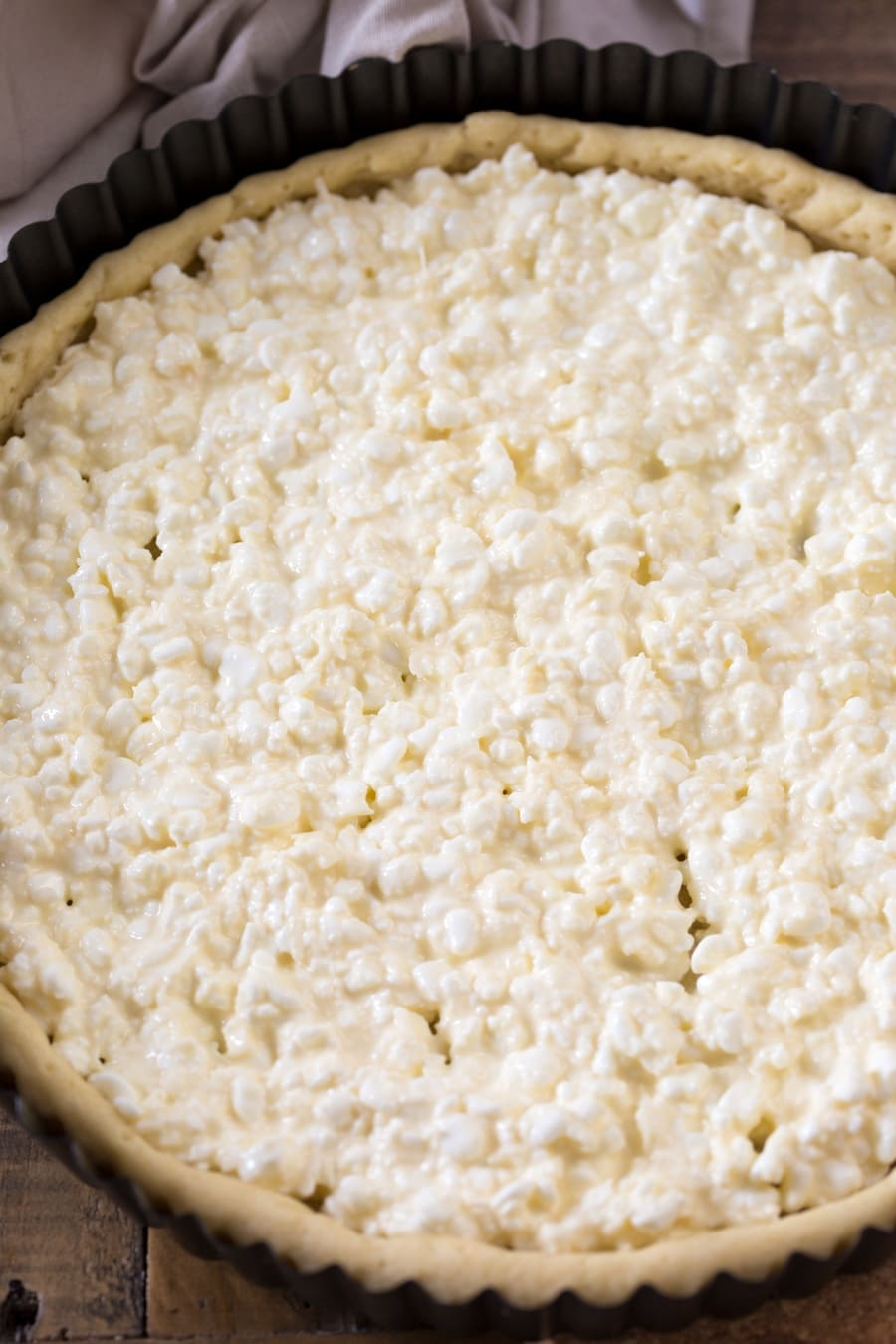 Pie crust filled with cottage cheese mixture.