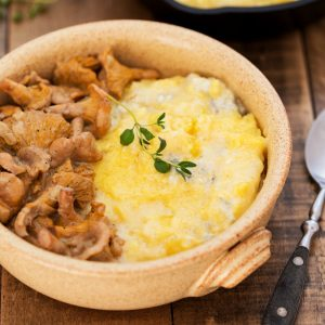 The richest polenta dish you can make, polenta concia with chanterelle sauce is a delicious vegetarian Alpine dish. Cheesy polenta with gorgonzola, taleggio and butter is served with a creamy and lighly tangy wild mushroom sauce. This is definitely a meal to remember, the best polenta recipe for cheese and mushroom lovers.