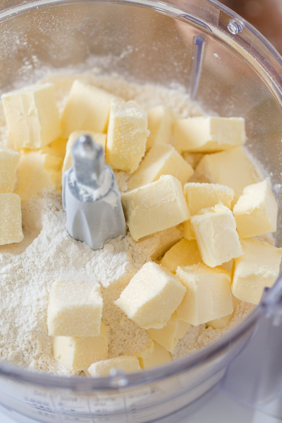 Cubed butter and flour in a food processor.