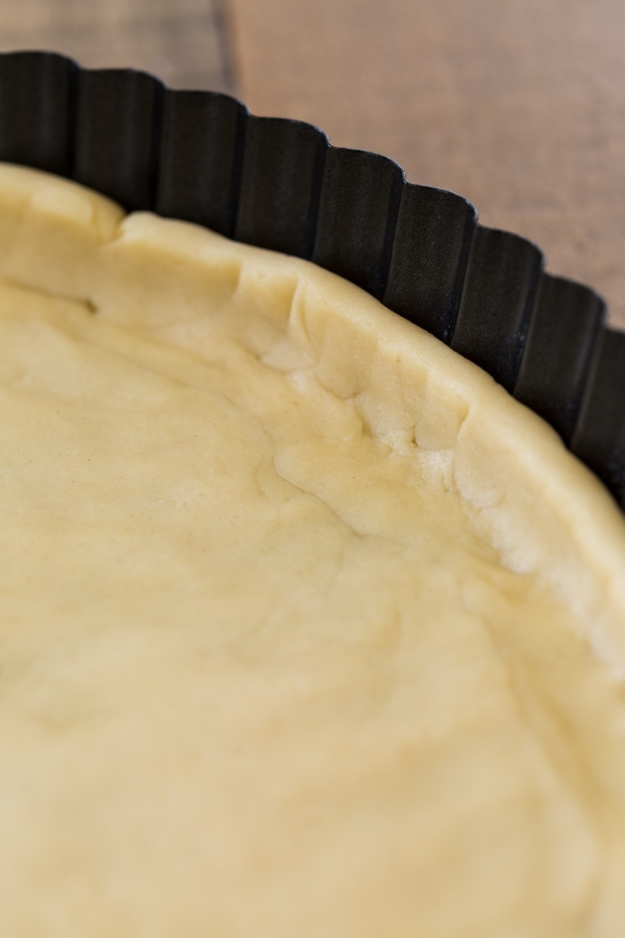 Shortcrust pastry in a tart tin.