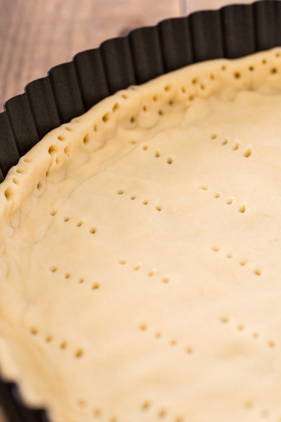 Shortcrust pastry that has been pricked with a fork.