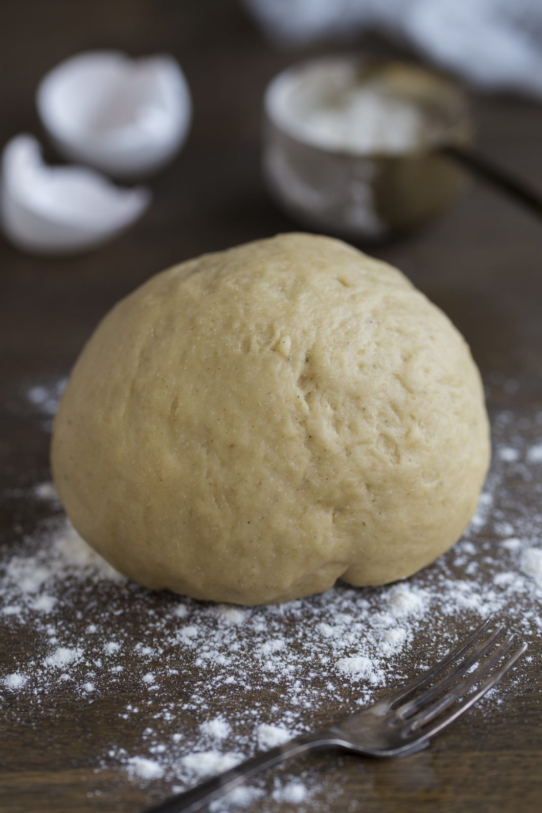 A ball of yeast dough on a floured surface.