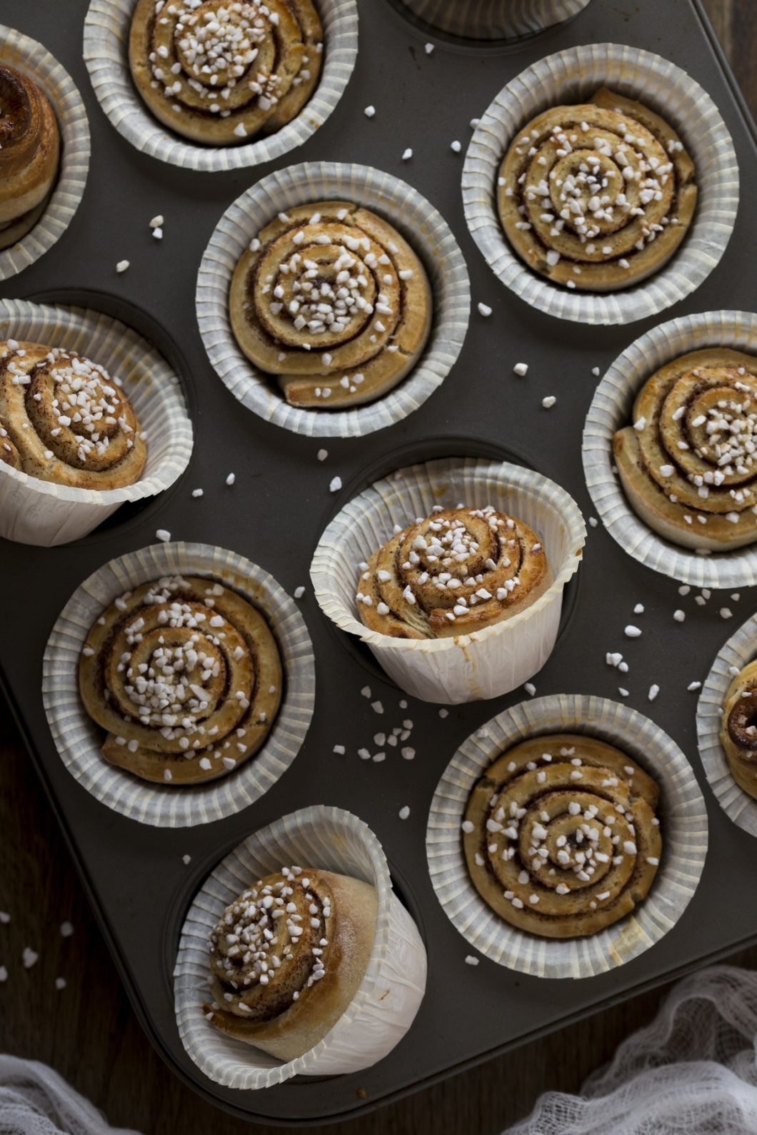 Miniature muffin tin kanelbulle buns baked in a muffin tin.