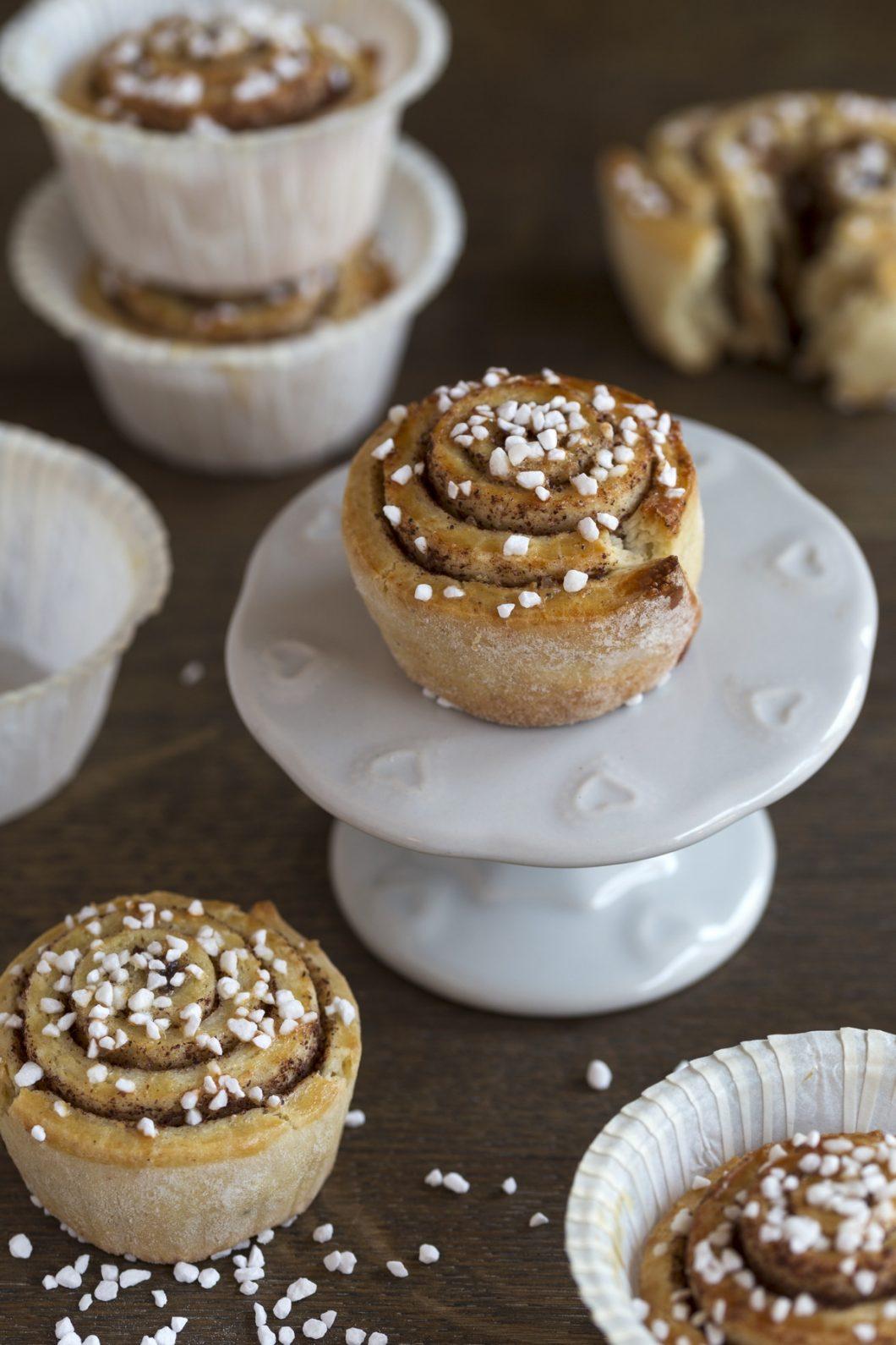 Mini cinnamon bun on a cupcake stand.