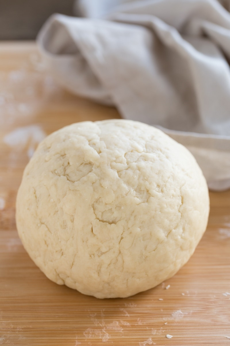 Dough ball on a wooden surface.