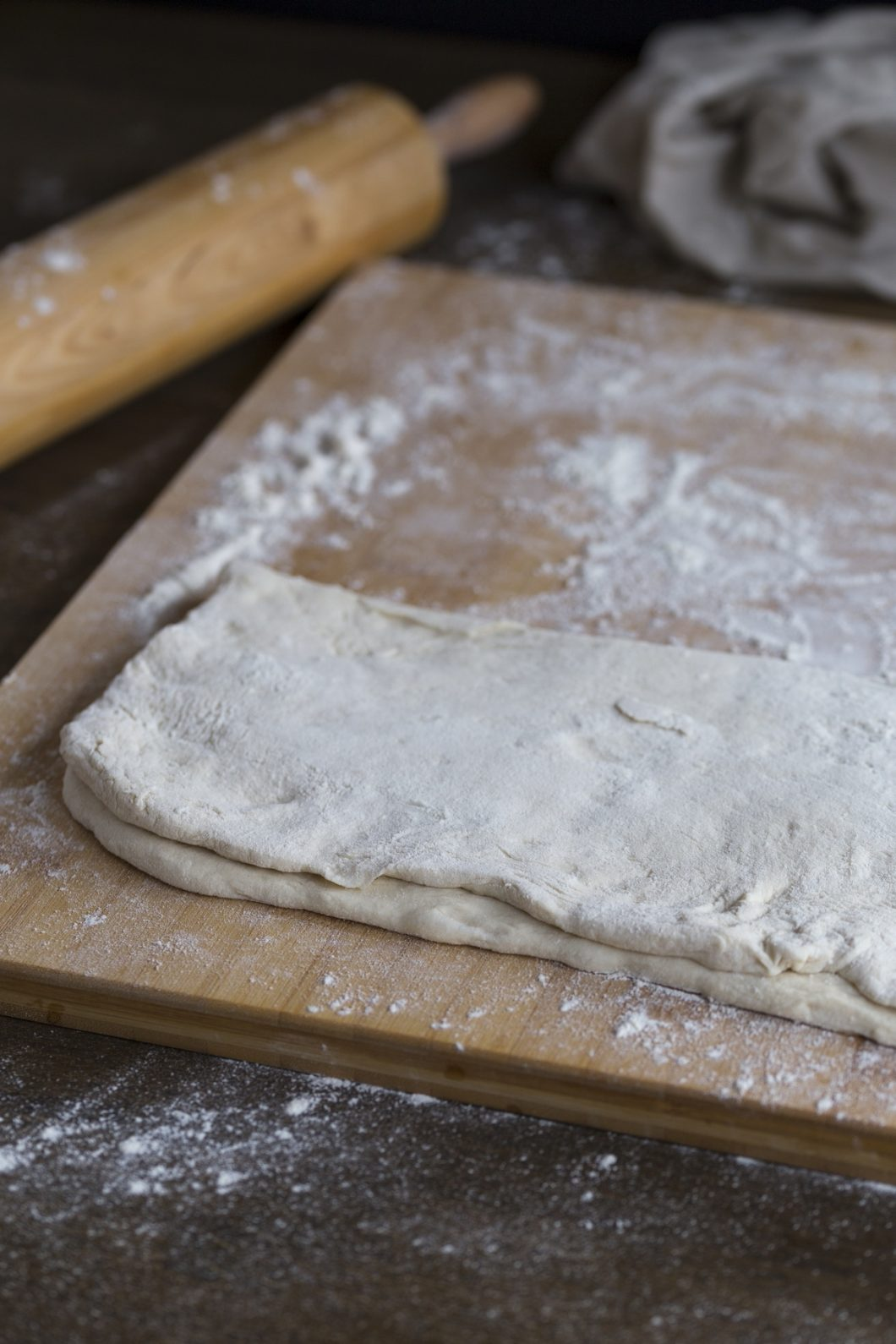 Dough folded on a wooden surface.