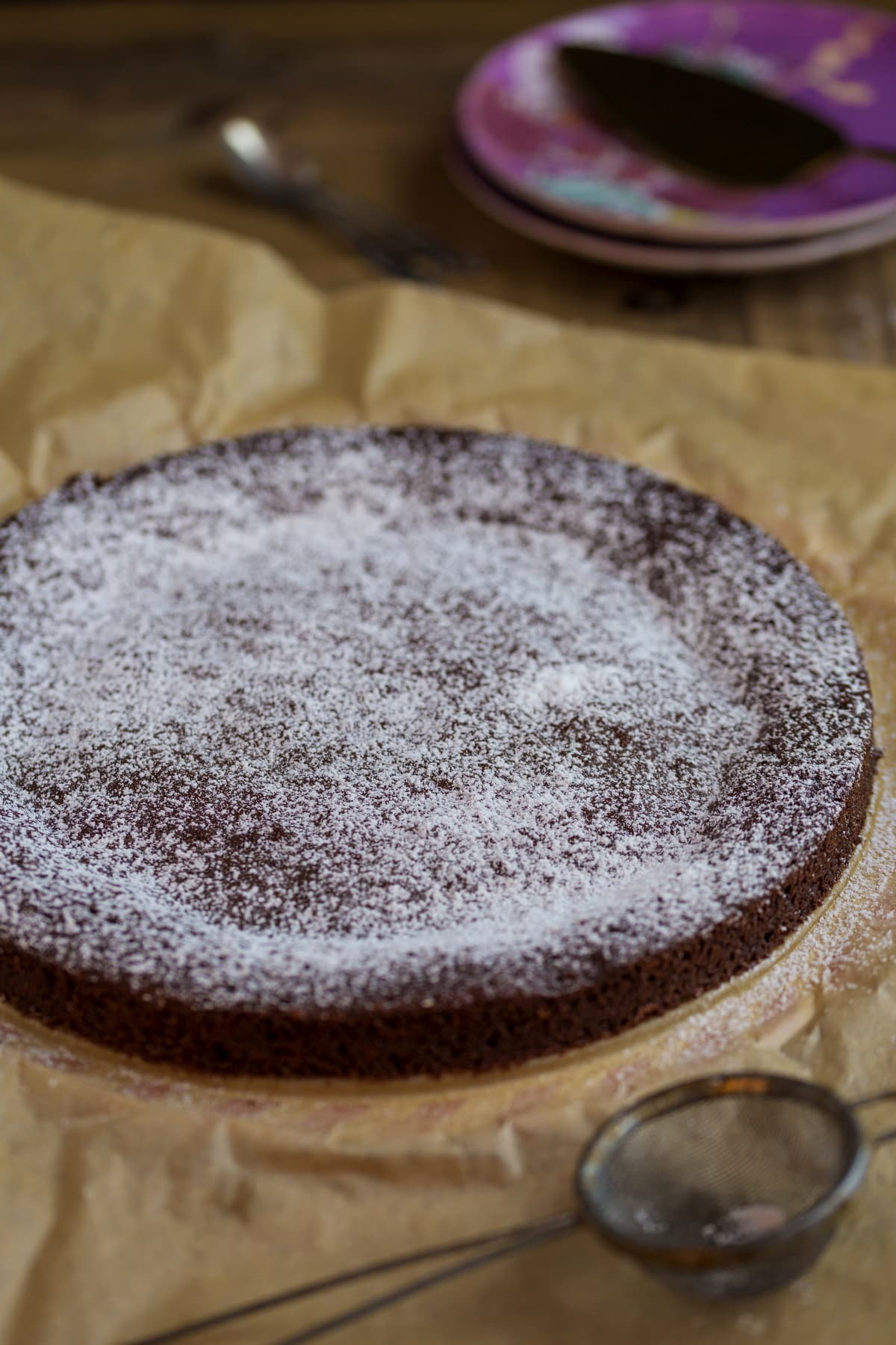 Chocolate cake dusted with confectioner's sugar.