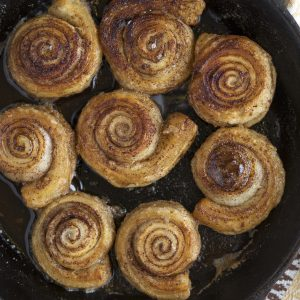 Skillet cinnamon rolls made with puff pastry.