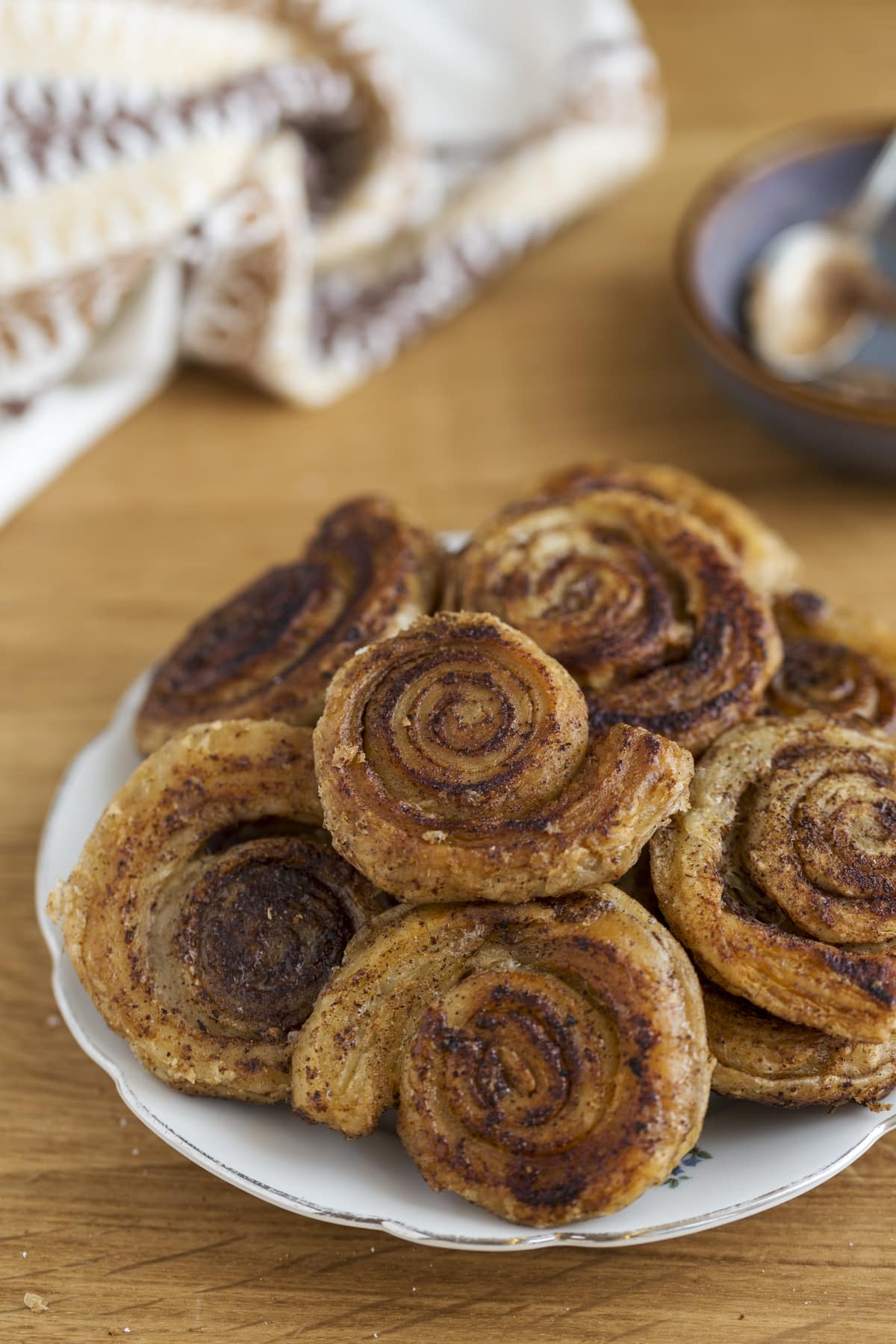 Cinnamon pinwheels piled on a serving plate.