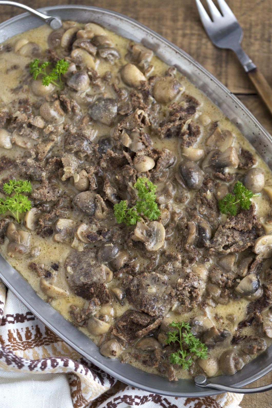 Reindeer stew with mushrooms in cream.