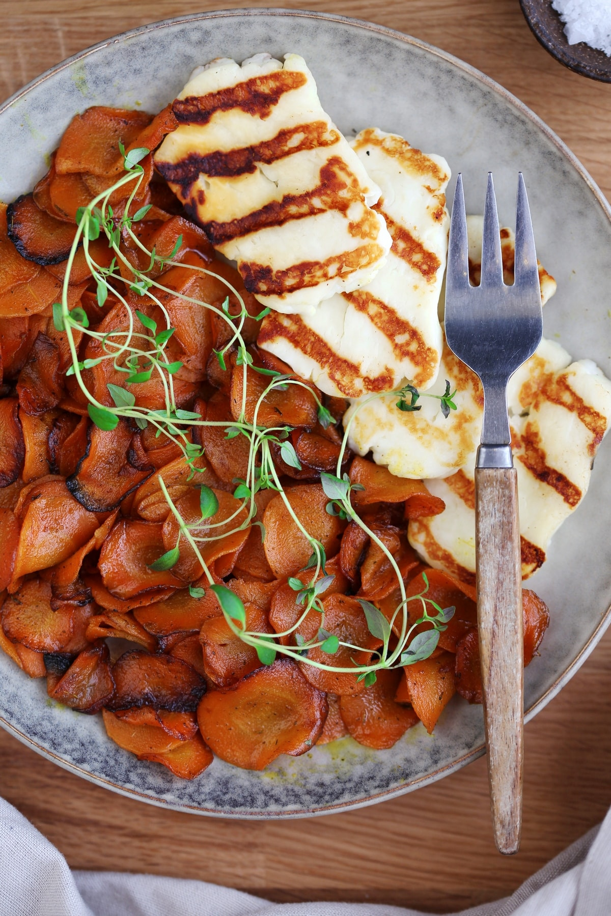 Sauteed carrots served as side dish to grilled halloumi.