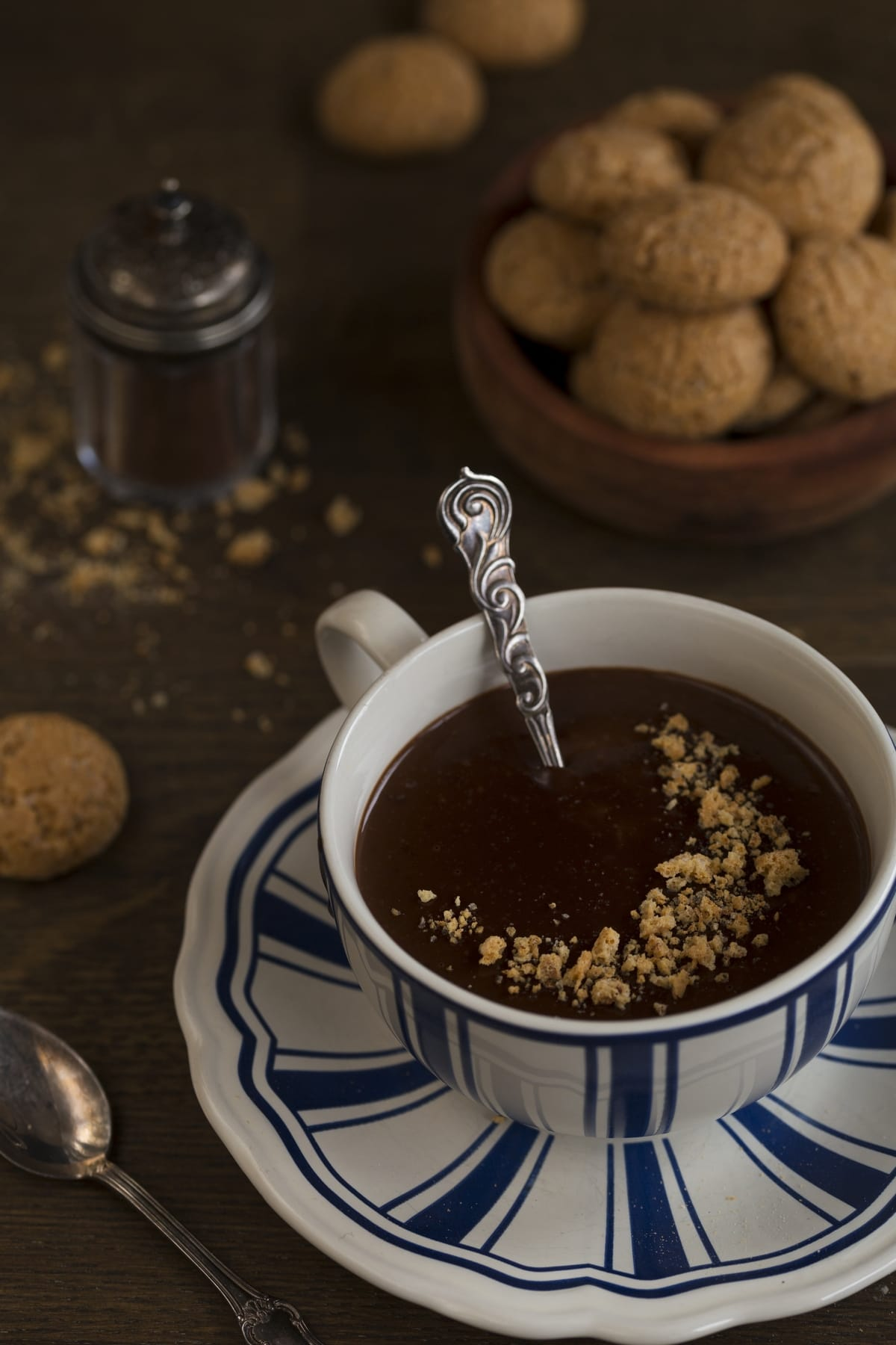 Thick hot chocolate with crushed amaretti cookies on top.