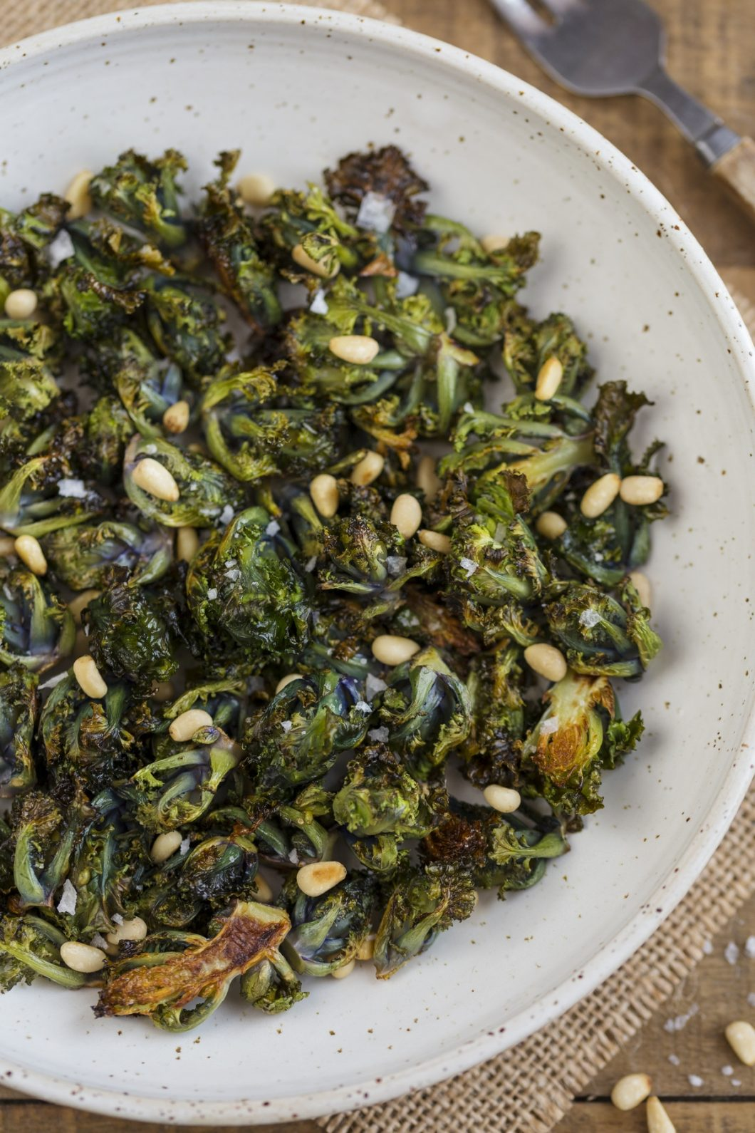 Closeup of roasted flower sprouts with pine nuts.