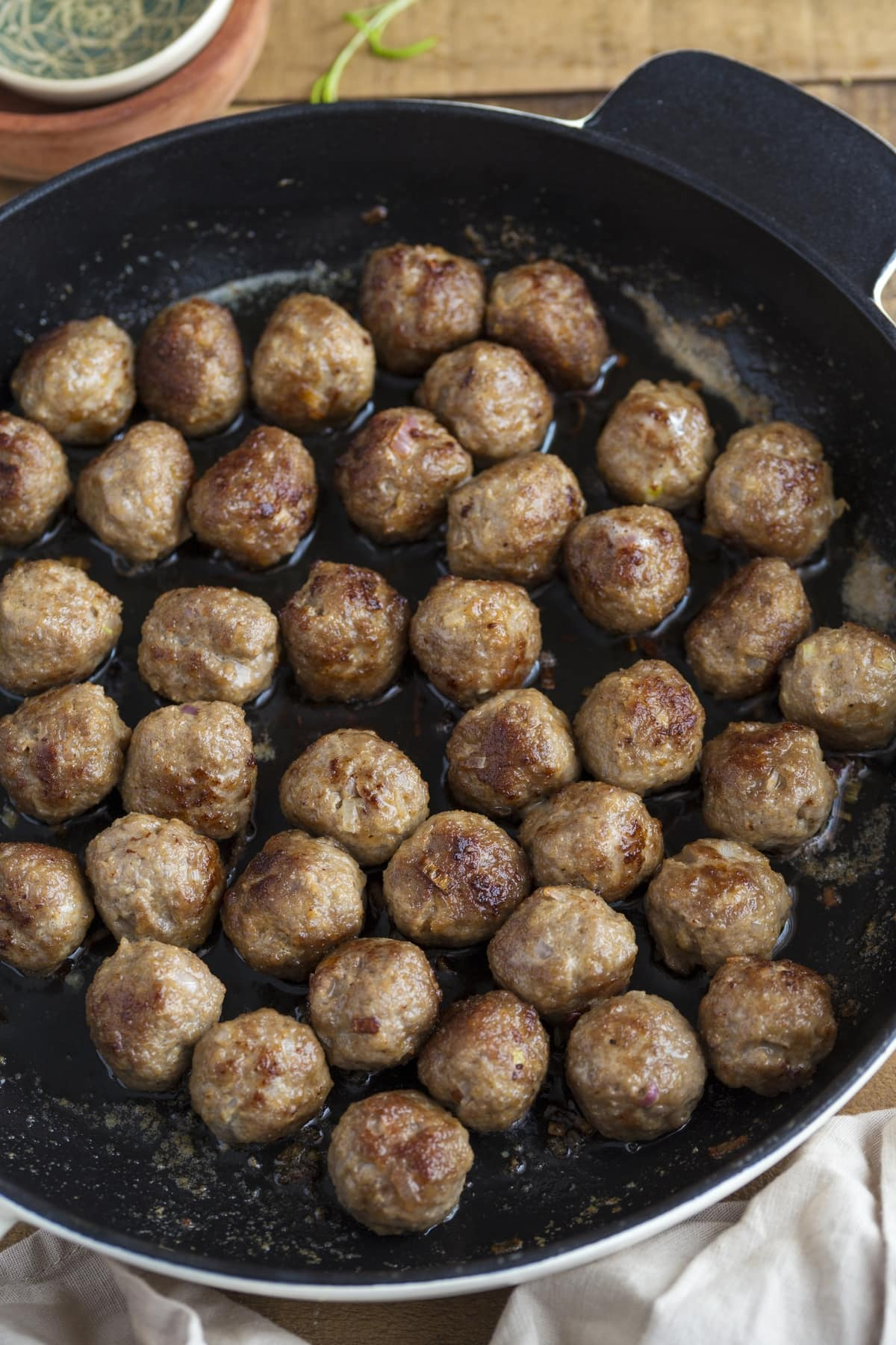 Frying meatballs in a skillet.
