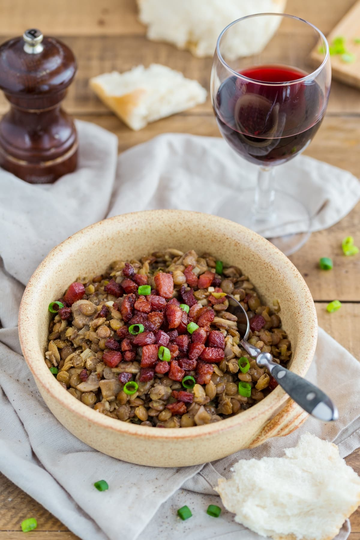 Lentil stew with crispy bacon and mushrooms.