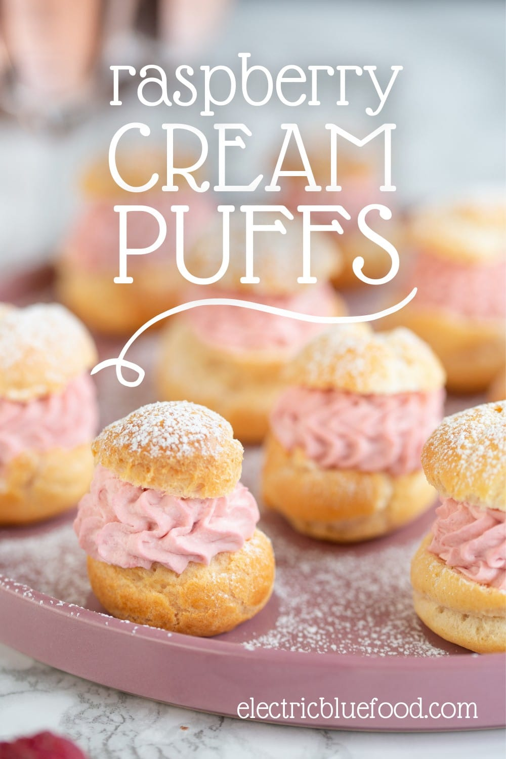 Homemade choux pastry puffs filled with a raspberry cream. These raspberry cream puffs from scratch are an elegant dessert to serve your guests. This small batch yields 10-12 puffs.