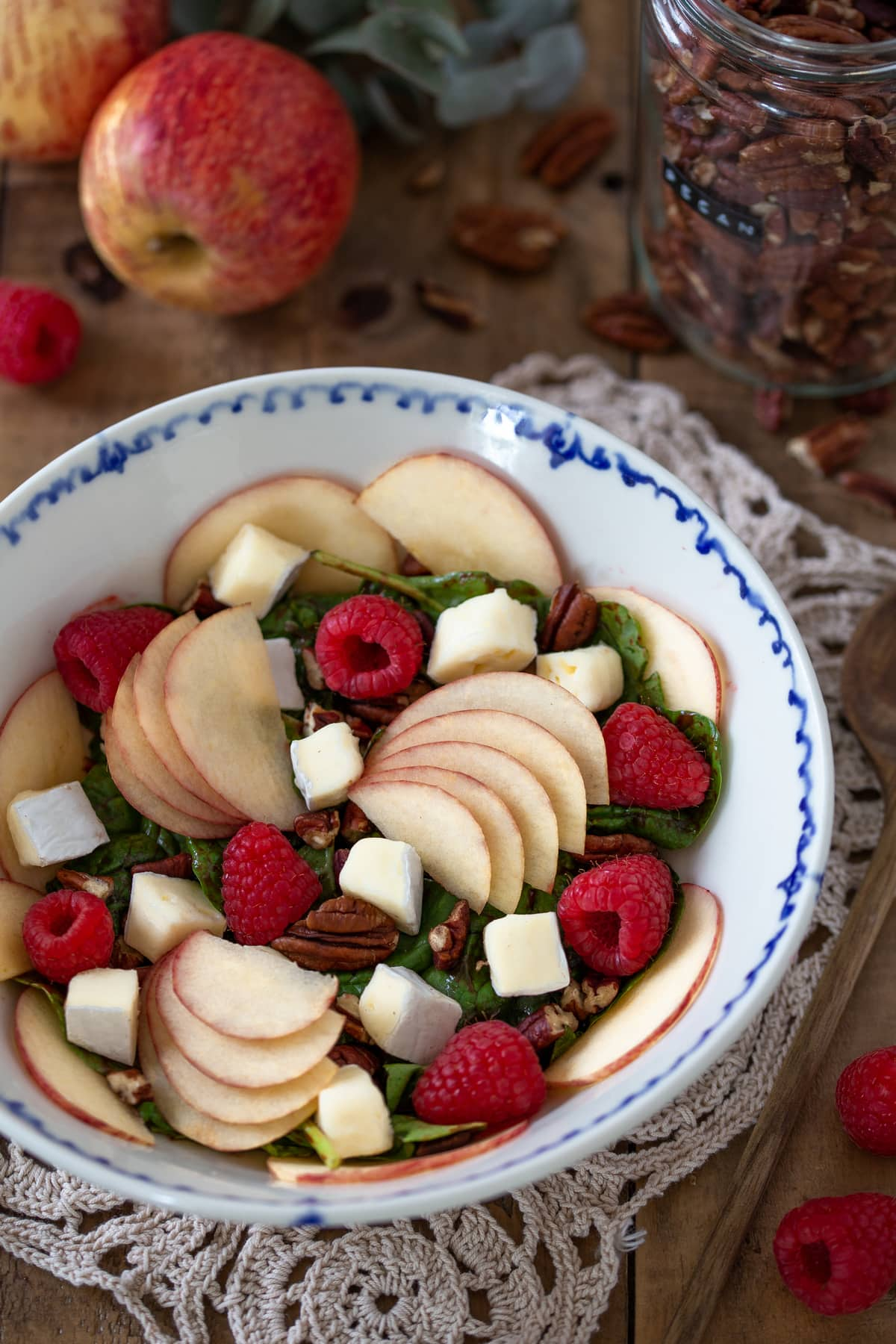 Apple brie salad with raspberries and pecans.