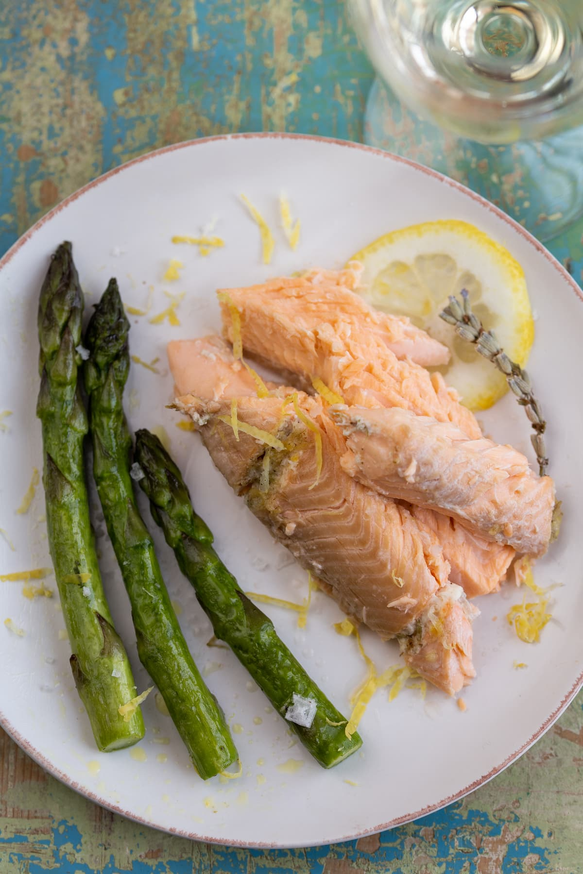 Baked trout fillets served with asparagus.