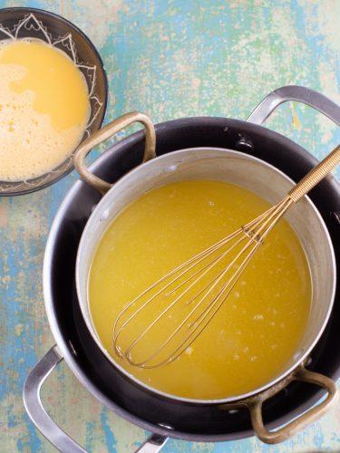 Making ginger lemon curd on a double boiler.