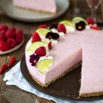 Pink cheesecake with a slice missing.