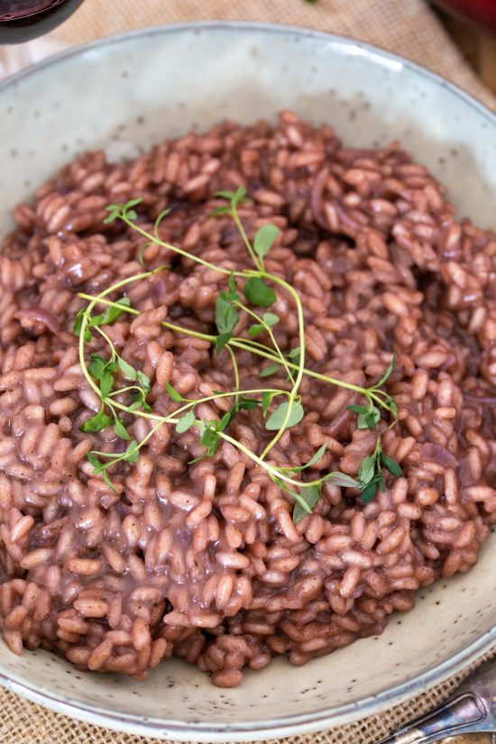 Closeup view of red wine risotto.