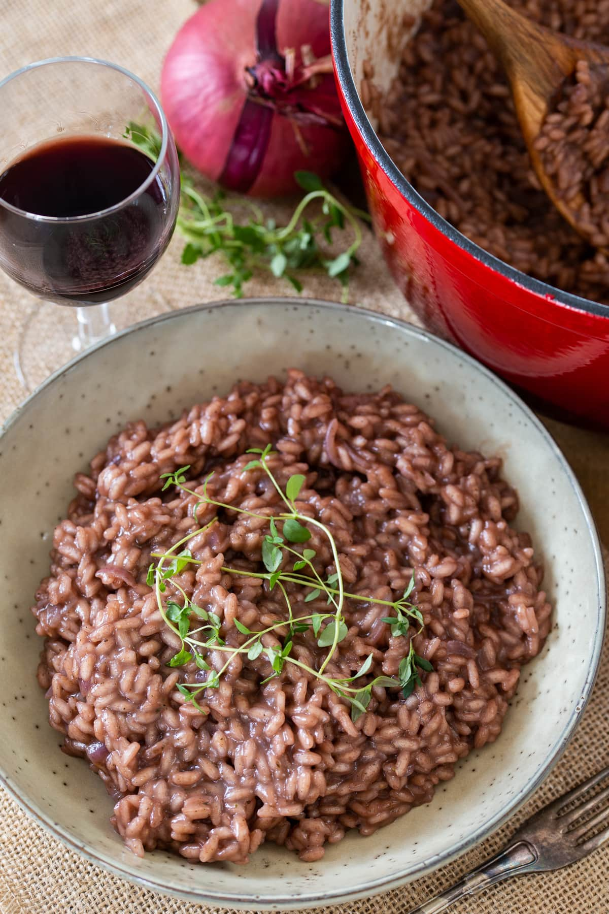 Simple red wine risotto topped with fresh thyme.